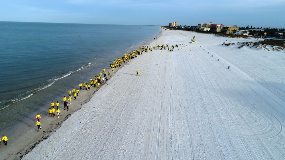 Participants head south on the beach from Palm Pavilion.