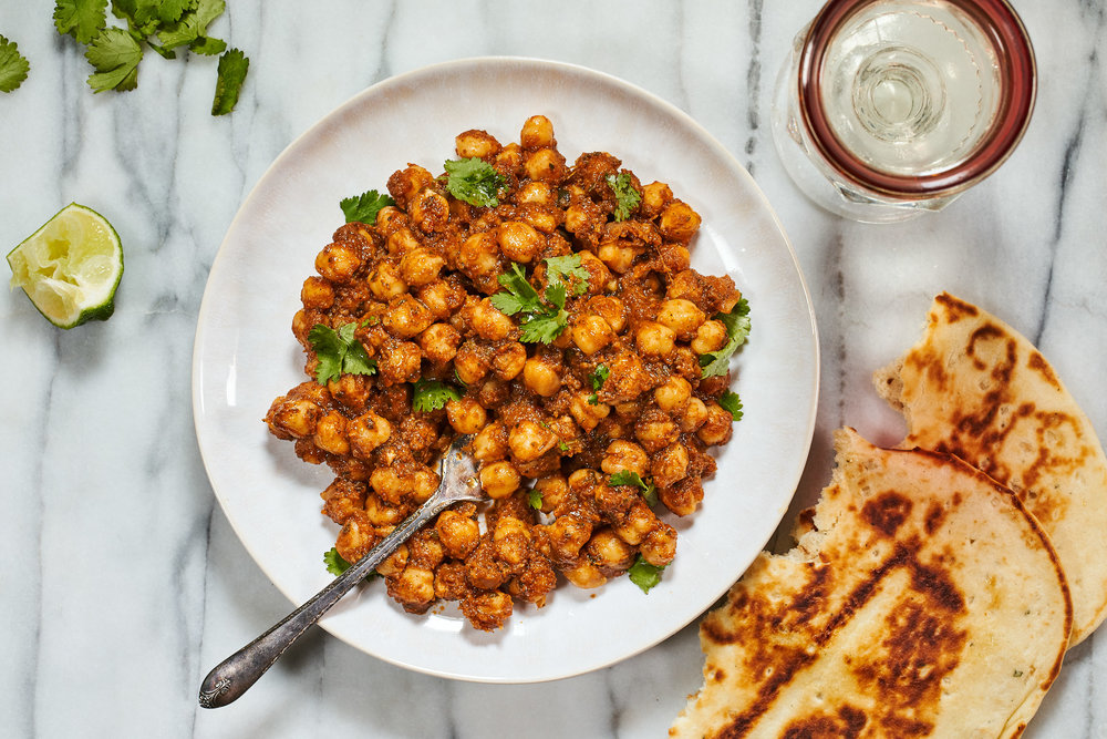 chana masala - drag a piece of hot naan through it.serves 42 tablespoons butter or ghee, divided1 tablespoon grated ginger2 teaspoons garam masala, or curry powder blend.2 12-ounce cans chickpeas, drained1 jar (16-oz) not just pasta sauce1/2 cup chopped fresh cilantro or mintcooked rice or naan to serve.1. in a large non-stick skillet over medium-high heat, heat 1 tablespoon of the butter or ghee, and saute ginger and garam masala or curry powder for about 30 seconds, until fragrant.2. stir in chickpeas and not just pasta sauce. reduce to medium-low and simmer for 10 minutes for flavors to meld. pull off heat and stir in cilantro or mint.3. stir in last tablespoon of butter, season to taste with salt and pepper, and serve over rice or with naan.
