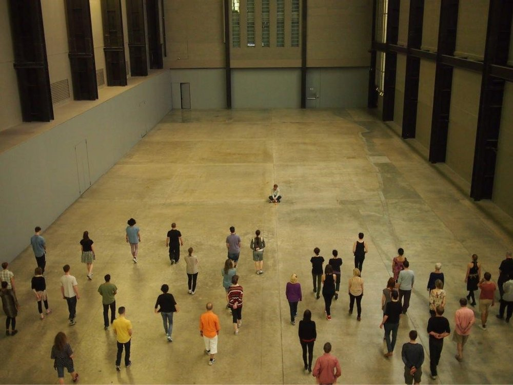 Tino Sehgal's  These Associations  at Tate's Turbine Hall . Image courtesy of the artist and Flickr.