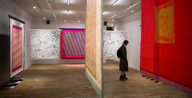Lisa Alvarado's bannerlike paintings at Bridget Donahue.  CreditMichael Nagle for The New York Times