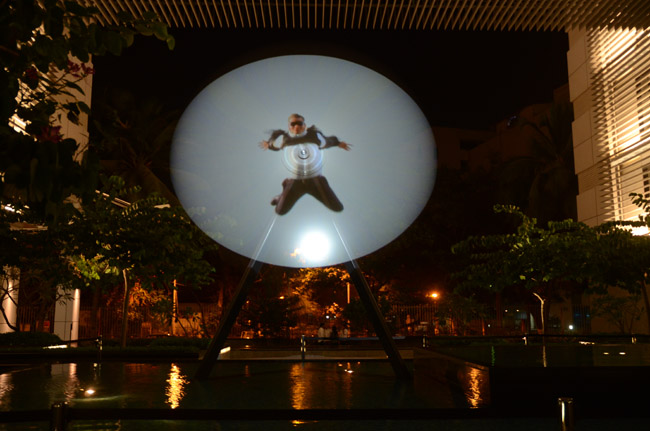 Eva Schlegel, installation view of video projection on rotor, Mumbai, 2012, rotor: 197 in height, 150 in diameter