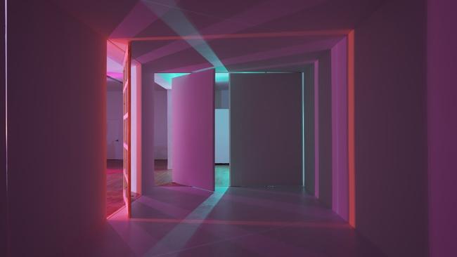 Chris Fraser, Revolving Doors, 2015, Installation, pivot doors, ambient light, flood lights, colored gels, various dimensions.