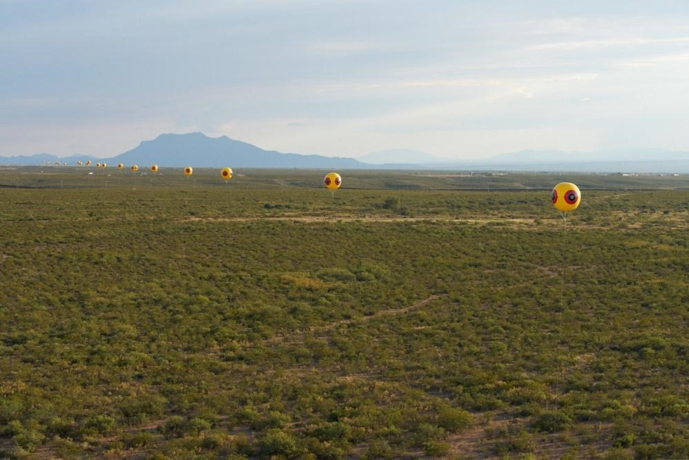 Postcommodity, Repellent Fence, Inflatable Balloons, 10'x10' each, Variable installation dimensions, 2015. Courtesy of the artists