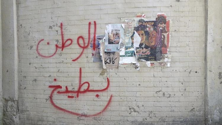 """A photograph taken in early June shows Arabic writing that translates to: """"Homeland is a watermelon."""" Graffiti artists asked to create set dressing for the Showtime series pranked the creators by coming up with nonsensical and subversive slogans.(Heba Amin / Associated Press)"""