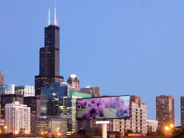 "A billboard featuring Judy Chicago's ""Purple Atmospheres,"" part of Expo Chicago's Override 
