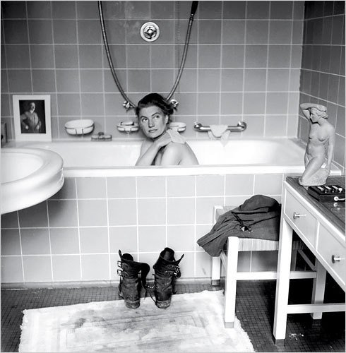 Miller in Hitler's bathtub (1945). Image via Messynesschic.