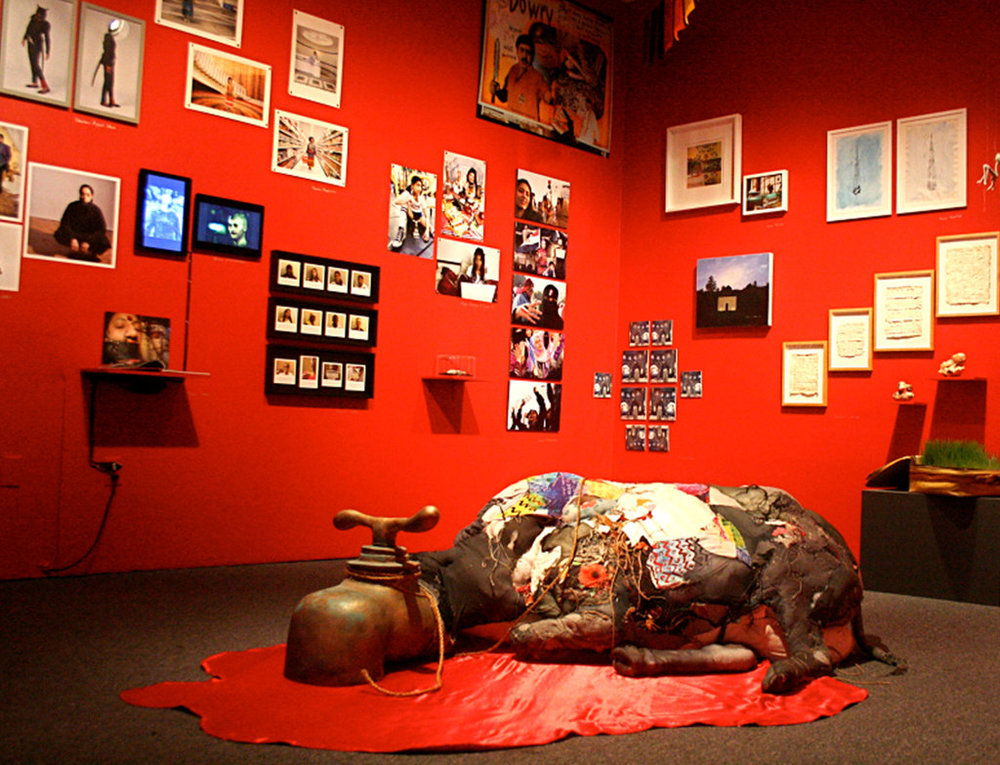"""An installation view of """"Her Stories: Fifteen Years of the South Asian Women's Creative Collective,"""" at the Queens Museum of Art. CreditJaishri Abichandani/Queens Museum of Art"""