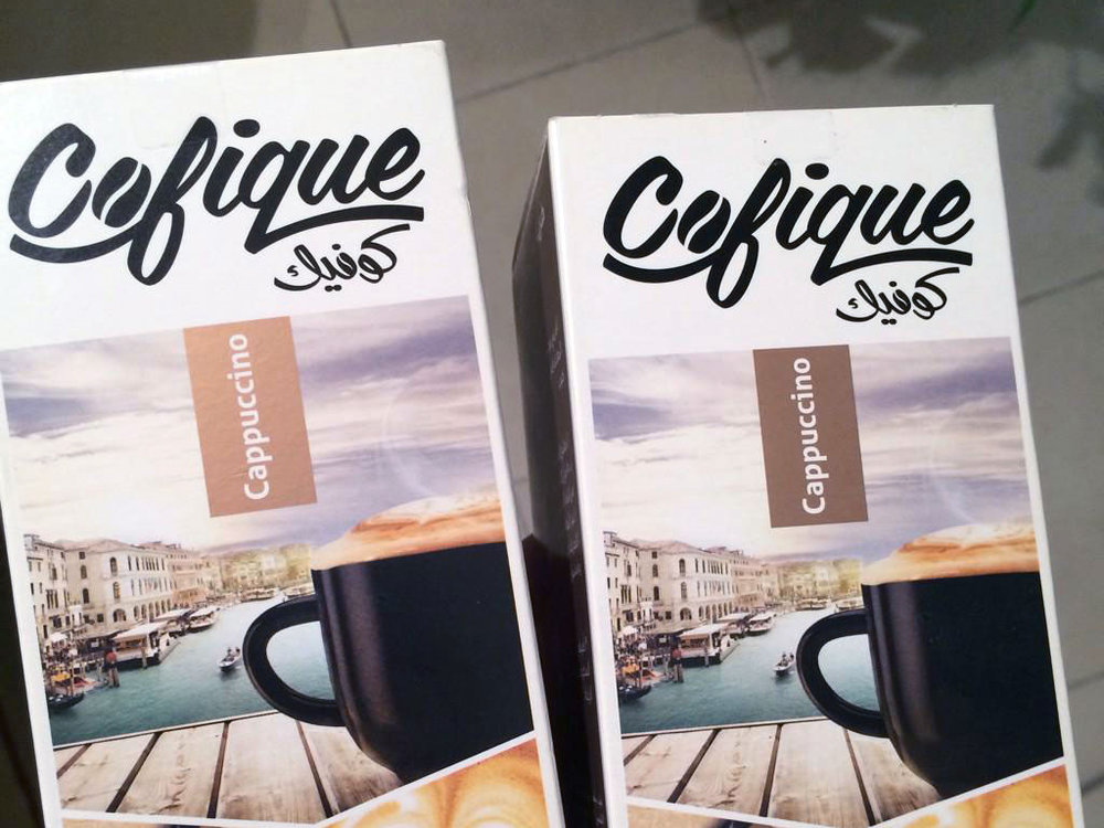 Cofique instant coffee bilingual logo applied to packaging  Role: Senior Brand Designer, Rayat Brands