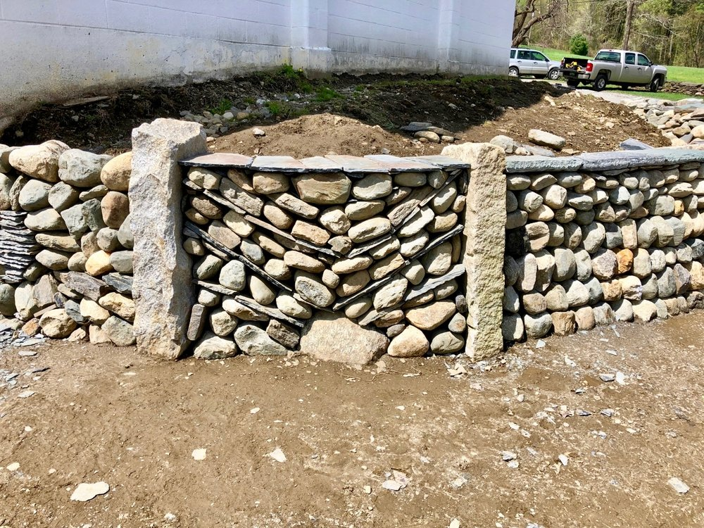 STONE TRUST FEATURES WALL
