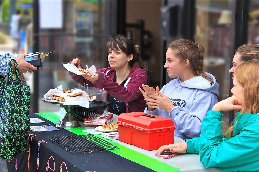 Leonie and Maddy selling waffles at the Swarthmore Fun Fair (2013)
