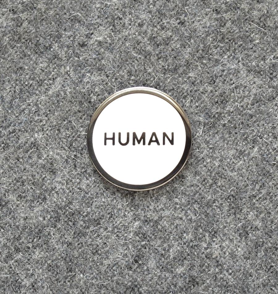 """Human"" enamel pin,  $10"