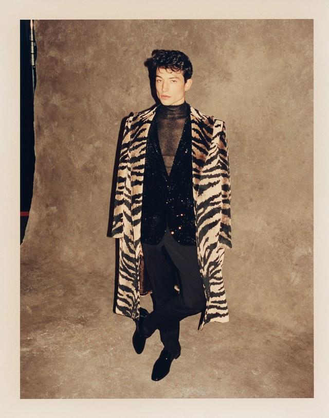 Duster coat: Alexander McQueen ($3,975); blazer: SSS World Corp ($750); pants: SSS World Corp ($275); turtleneck: Hermès ($1,575); shoes: Christian Louboutin ($795)
