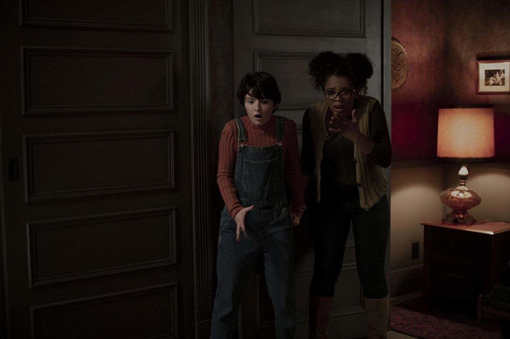 Lachlan Watson as Susie Putnam alongside Jaz Sinclair as Roz