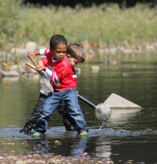 Meno. River Kids Pic_boy in river.png