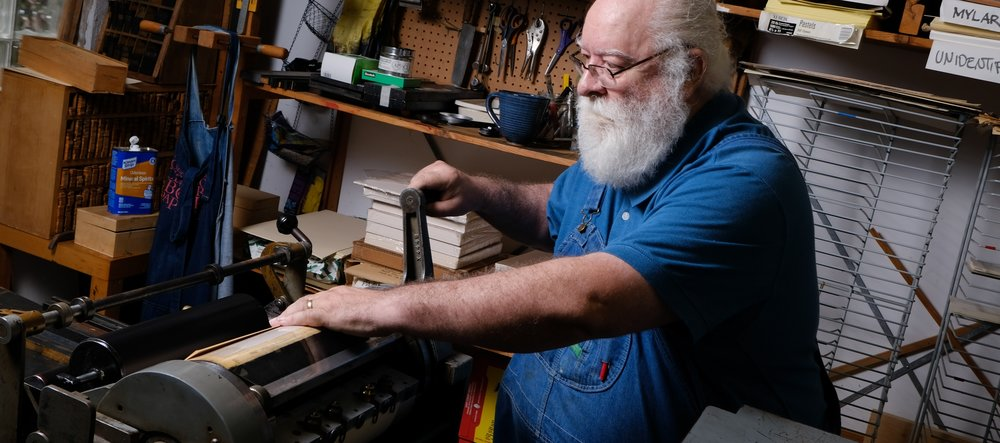 Craig Jobson creates book art, for which he sets the type one letter at a time, right here in Evanston at his Lark Sparrow Press.   Have a look as Craig cranks his press and gets some ink on paper →