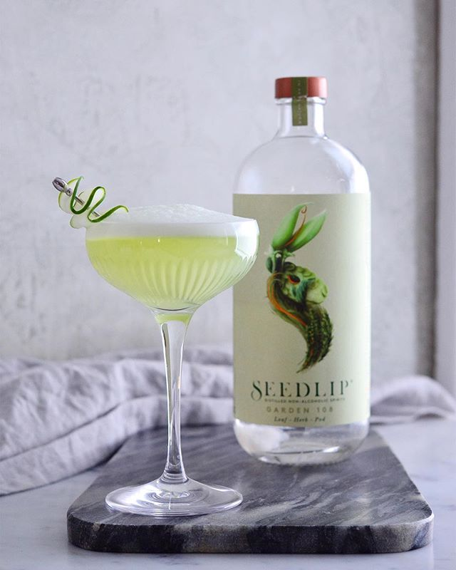 This is something of a first for the blog - a cocktail with no alcohol at all. That's right, it's my very first mocktail. . It all began when the good folks at @seedlipdrinks sent me a bottle of their Garden 108, a spirit that (like gin) is distilled with a mix of botanicals, but (unlike gin) is completely non-alcoholic. It's made with peas and hay and garden herbs and tastes more like summer than anything else I've ever drank. It also tastes a tiny bit like a pickle, and like one of those high-end home stores with $70 candles that smell like something from your wildest dreams. It's very good on its own, or with a little bit of seltzer, but I wanted to make it into a real, true, bona fide non-alcoholic cocktail. . I had some cucumber juice, from a past cocktail experiment, and I happen to know that celery bitters pair very well with garden-y flavors, because I try to put celery in everything. Add to that an egg white, for a little texture, and you're starting to get the idea. . Seedlip Summer Sour 2.5 oz Seedlip Garden .5 oz simple syrup .5 oz lime juice .5 oz cucumber juice egg white dash of celery bitters . Put all the ingredients in your shaker and shake vigorously for 60 seconds. Then add ice, shake again, and strain into a glass. (If you feel so inclined, you can opt instead for the reverse dry shake: as this photo proves, that is a great way to get a whole whole lot of foam.) Cheers to the flavors of summer, and to a drink that anybody (even your teetotaling friends) can enjoy.