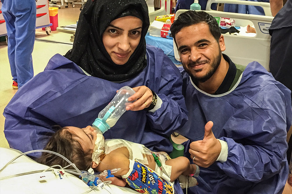 - Mosul parents Ashmaq and Saif with their three-month-old son Sajad after a successful open-heart surgery through the Novick Cardiac Alliance at the Al Kafeel Specialty Hospital.Location: Karbala, Iraq