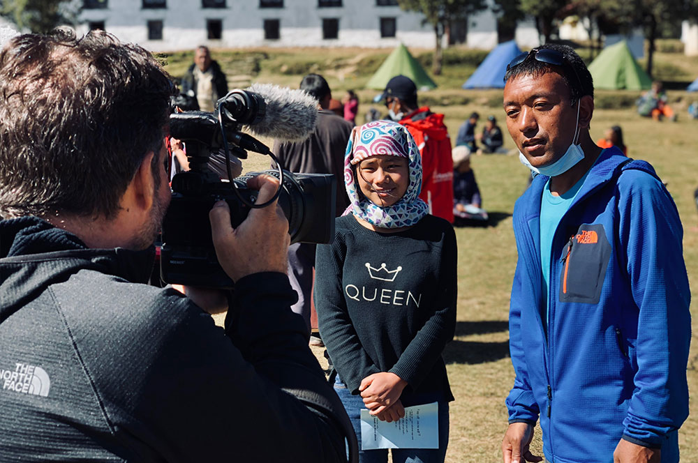- Ramro Global Ambassador, Adrian Belic, interviews Karma Sherpa during a three-day medical camp in Nepal's mountainous Solu Khumbu region.Location: Taksindu, Nepal