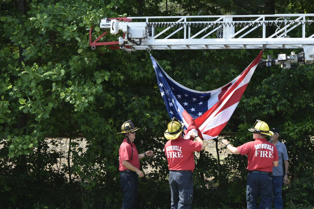 Raising of the flag by Hopewell Fire Department