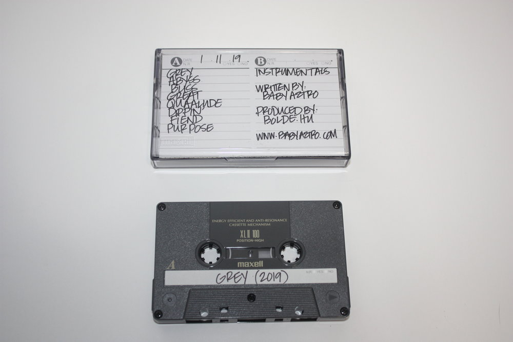 """GREY CASSETTE TAPE - """"grey"""" cassette ($20)Release: Friday, February 22nd(Recorded on Dead stock original Maxwell cassette tapes)Limited to 7 copies.Side A: grey (album)Side B: grey (instrumentals)*First 3 orders will include a FREE 12""""x12"""" """"grey"""" painting*available exclusively on cassette only."""