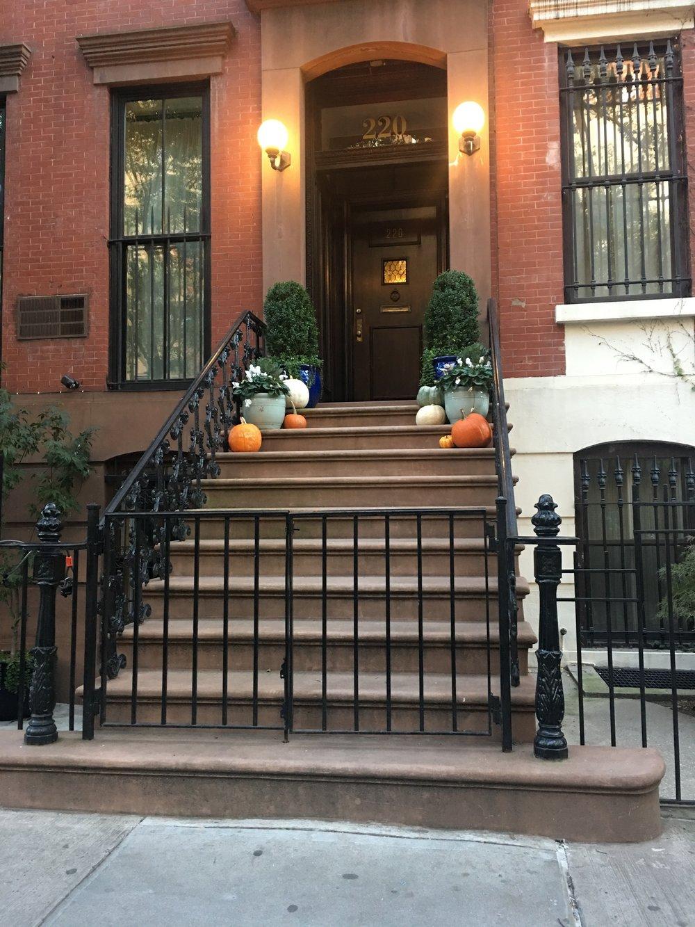 Brownstone house with pumpkins.jpg