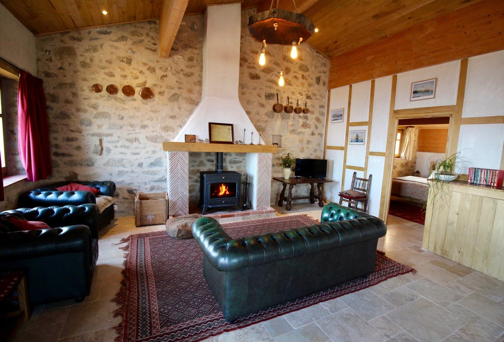 Powerful wood burning stove and comfortable lounge
