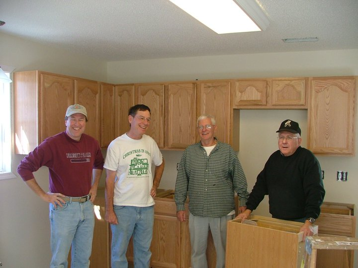 4-workers-w-cabinets.jpg