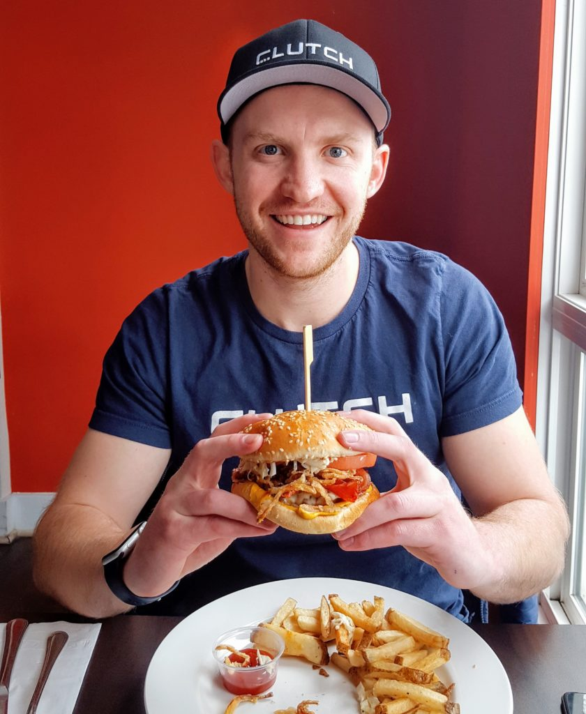 Andrew, our Co-Founder, having the first bite of the Hulk Burger