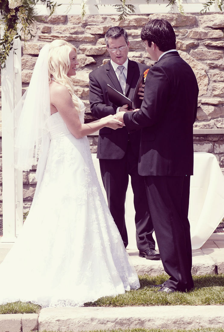 Near Columbus Ohio, Ben looks at wedding officiant Damian King waiting for the ring