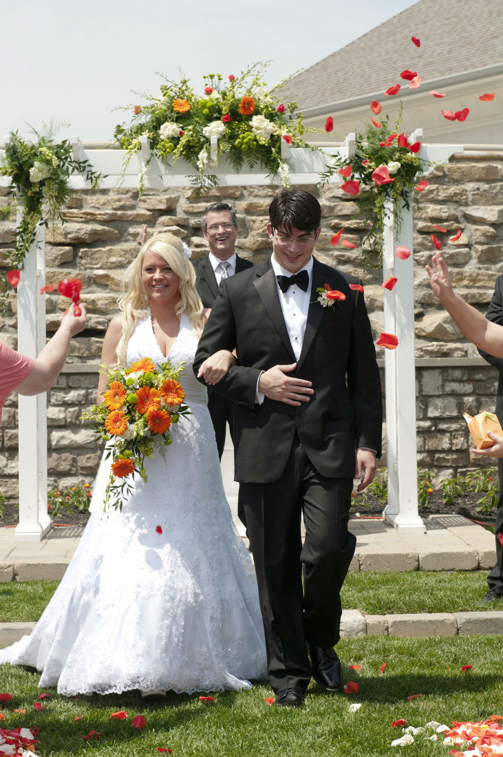 Teresa and Ben walk after officiant Damian King presents the bride and groom