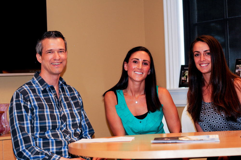 Colleen Tassone and Ariana Tyler meet with wedding officiant Damian King in Columbus