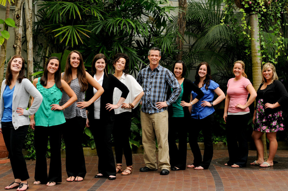 Columbus OH officiant Damian King stands with the wedding professionals of Franklin Park Conservatory
