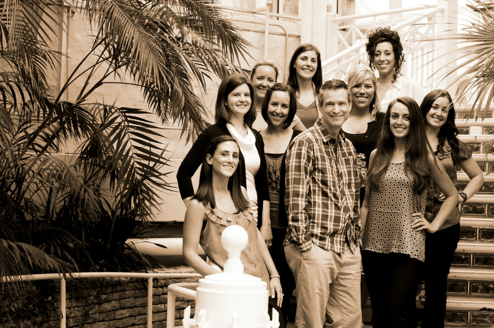 Palm House steps, officiant Damian King, stands with the wedding pros of the Conservatory in Columbus