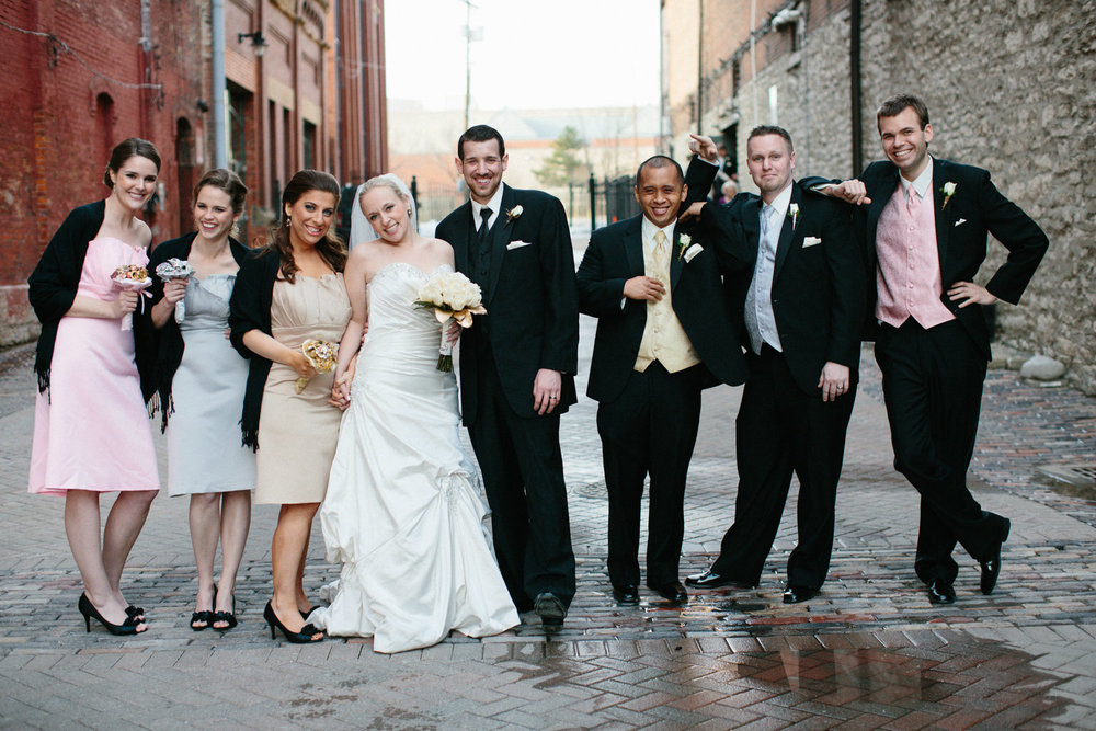 Bride and groom with bridal party outdoors at wedding venue, Via Vecchia, in Columbus OH