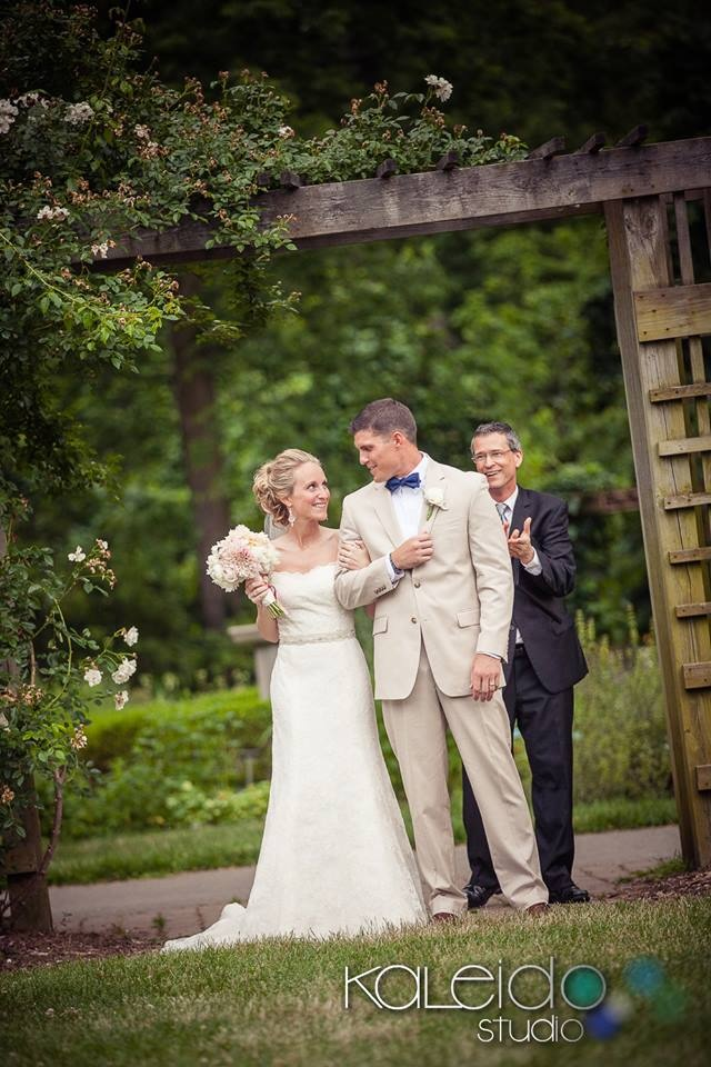 Bride & groom exit at Whetstone Park Columbus Ohio with wedding officiant in background