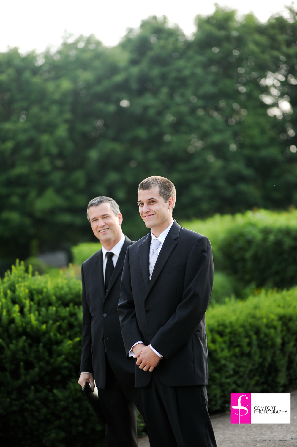 Groom with wedding officiant, Damian King, waiting for his bride in Columbus, Ohio at Franklin Park Conservatory