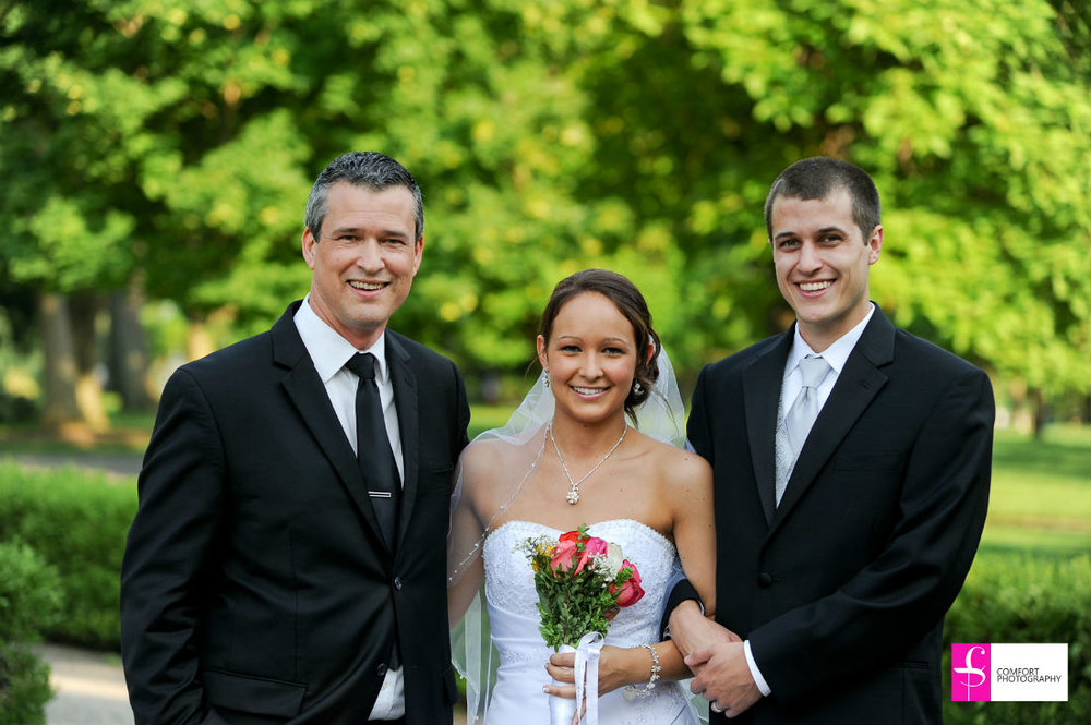 Columbus, Ohio, Jessica and Daniel stand with their wedding officiant, Damian, at Franklin Park Conservatory