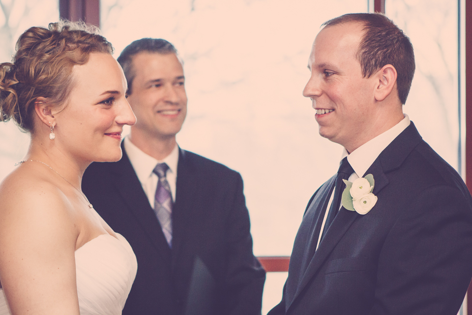Photographer, Dan Buckley, captures officiant, bride, and groom in Columbus, Ohio