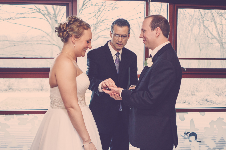 wedding ring placed by officiant in groom's hand in Columbus Ohio