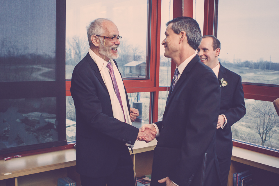 Dan Buckley Photography of Columbus captures wedding officiant shaking hands with Derek's father