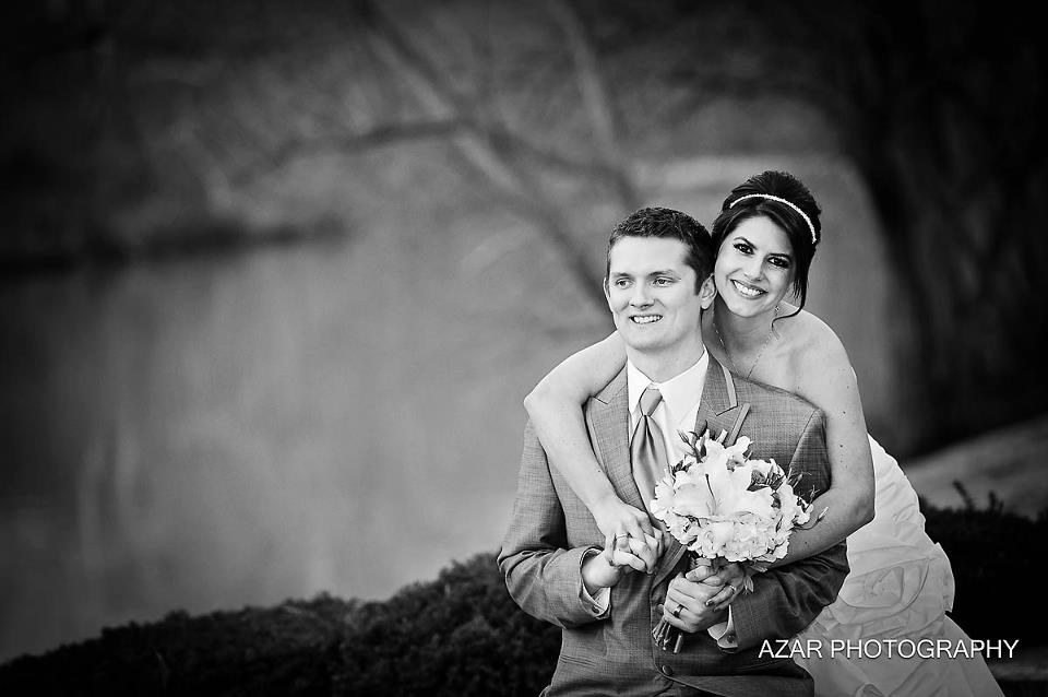 Azar Photography after wedding ceremony over - bride and groom hold bouquet in gentle pose.