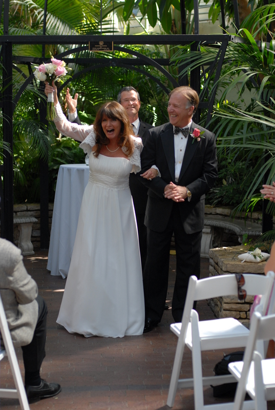 Wedding officiant Damian King pronounces Pam and Rick husband and wife at Franklin Park Conservatory in Columbus Ohio