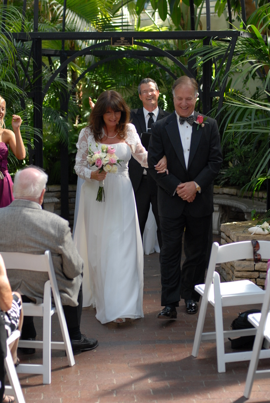 Damian King as wedding officiant with Pam and Rick in Palm House wedding