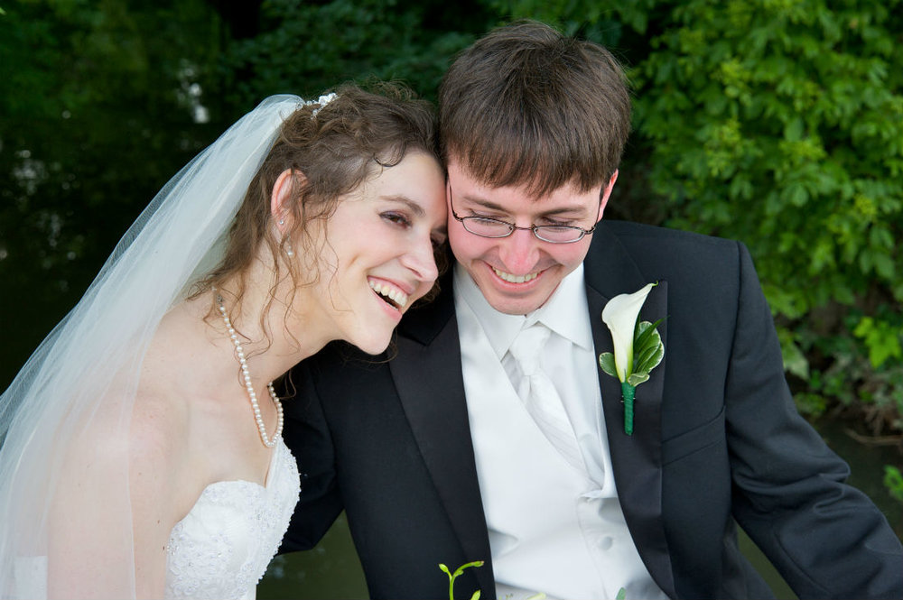 Alison and Justin marry in Columbus, Ohio. Their wedding officiant was Damian King.