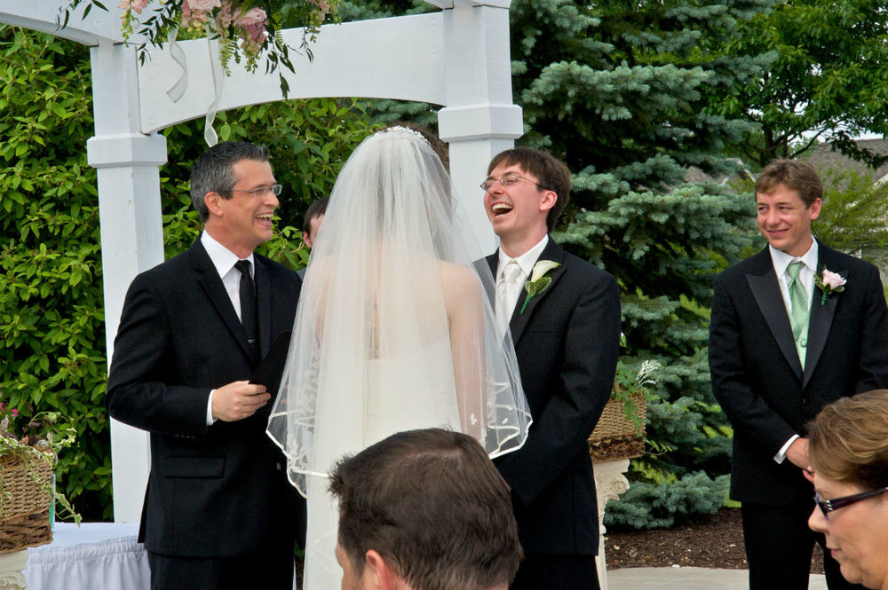 Wedding officiant Damian King laughs in Columbus Ohio at Alison and Justin's ceremony