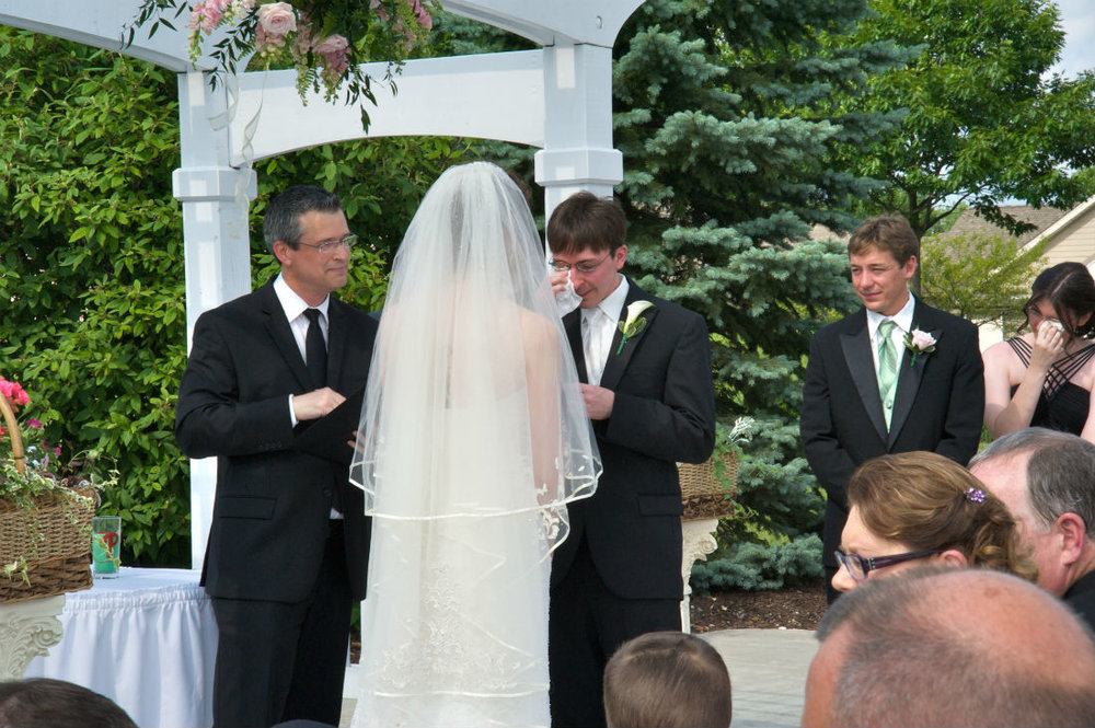 Justin expresses emotion for his bride during his wedding ceremony in Hilliard, Ohio