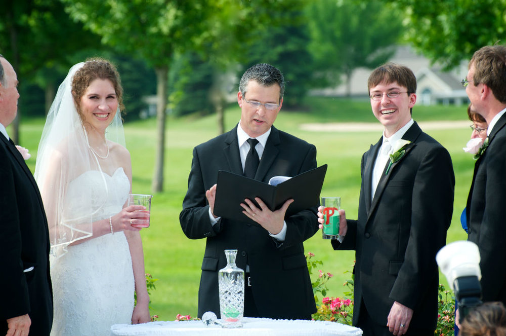 Sand Ceremony for their wedding in Columbus, Ohio. Damian prepares to read.