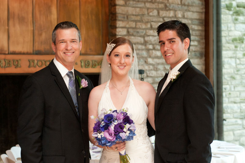 Jenny and Diego pose with wedding officiant, Damian King at Darby House in Columbus, Ohio