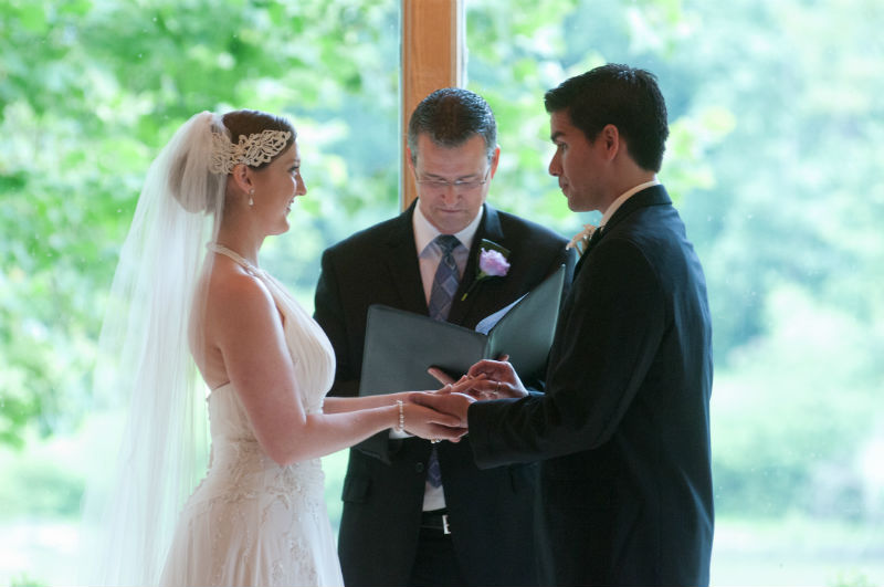 Damian King witnesses as wedding officiant as Diego gives the ring to his bride at Darby House, Galloway, Ohio