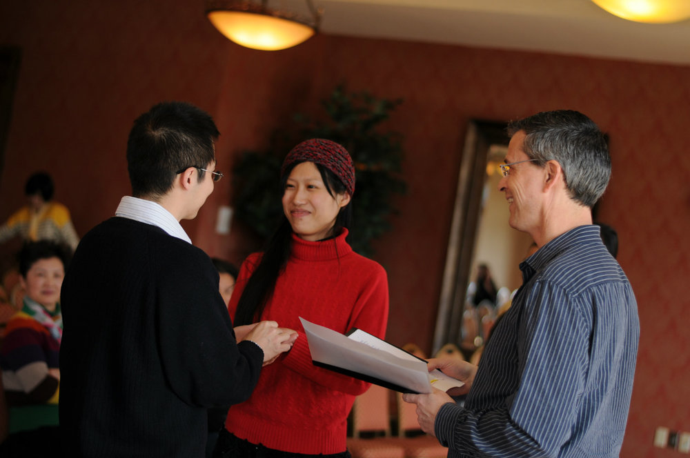 Damian King with bride and groom, Jia Shi and Bin Zhu, for United Marriage Services LLC
